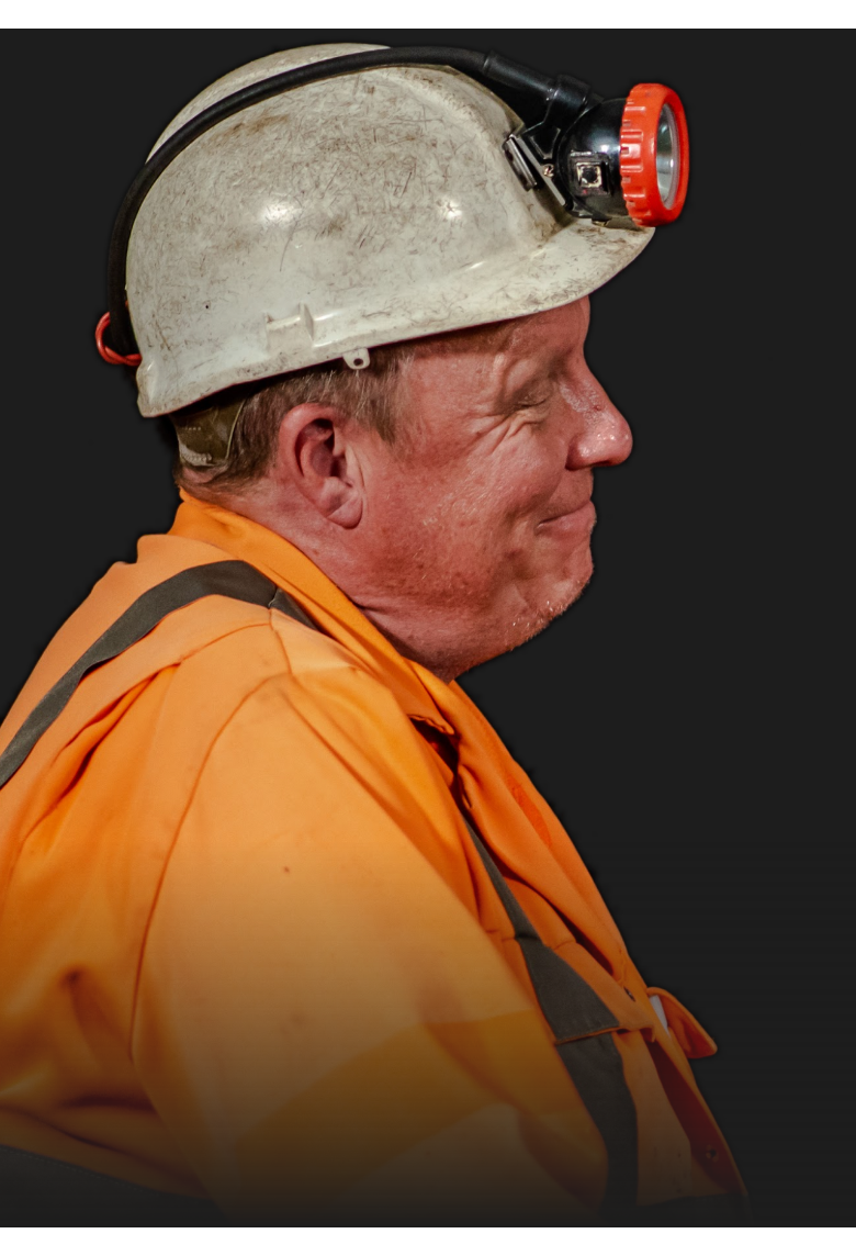 Image of a Miner looking to the right