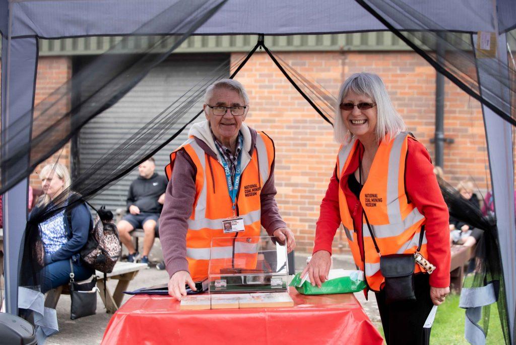 Two volunteers demonstrate activities to the public